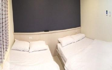 台中酒店公寓住宿:近逢甲夜市,提供简单,宽敞,明亮的套房空