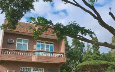 桃园酒店公寓住宿:桃园机场附近的宁静绿色庄园屋