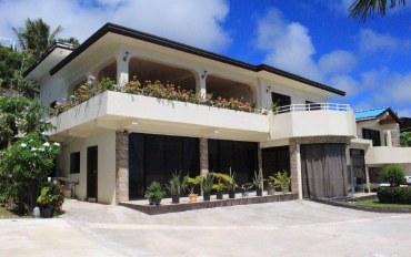 塞班岛酒店公寓住宿:优雅怡人的海湾别墅