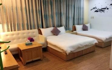 高雄酒店公寓住宿:85异国假期中庭主题四人房