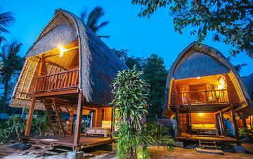 巴厘岛酒店公寓住宿:苏卡努萨奢华小屋酒店标准大床房