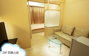 高雄酒店公寓住宿:85大楼绵羊海中庭-四季之旅大床房