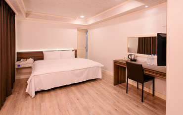桃园酒店公寓住宿:伯爵商务旅馆高级大床房