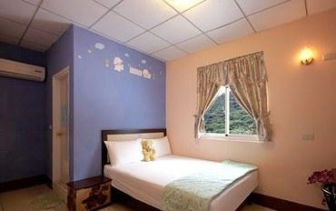 台东酒店公寓住宿:绿岛上园民宿精致双人大床房