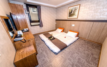 济州岛酒店公寓住宿:花筑·济州岛梦幻酒店温暖地铺标准双床房