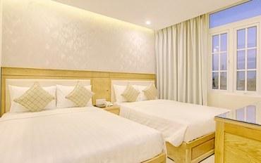 岘港酒店公寓住宿:岘港海城堡酒店高级四人房