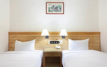 桃园酒店公寓住宿:原鹤商务饭店商务大床房